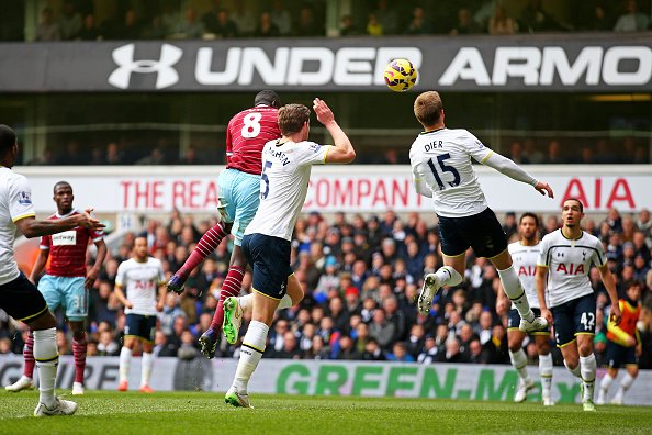 Cheikhou Kouyate of West Ham rises above Jan Vertonghen of Spurs