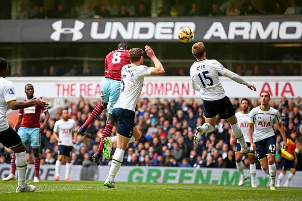 Cheikhou Kouyate of West Ham rises above Jan Vertonghen of Spurs