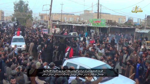 Watch: Isis militants parade 21 captive Peshmerga fighters in cages
