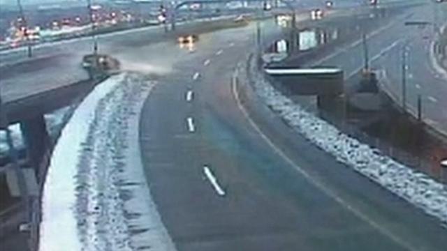 Watch: Driver crashes through overpass barricade and plummets to street below