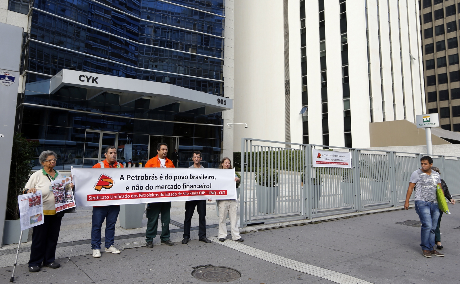 Petrobras' workers hold a banner in front of the Petrobras headquarters in Sao Paulo February 6, 2015.