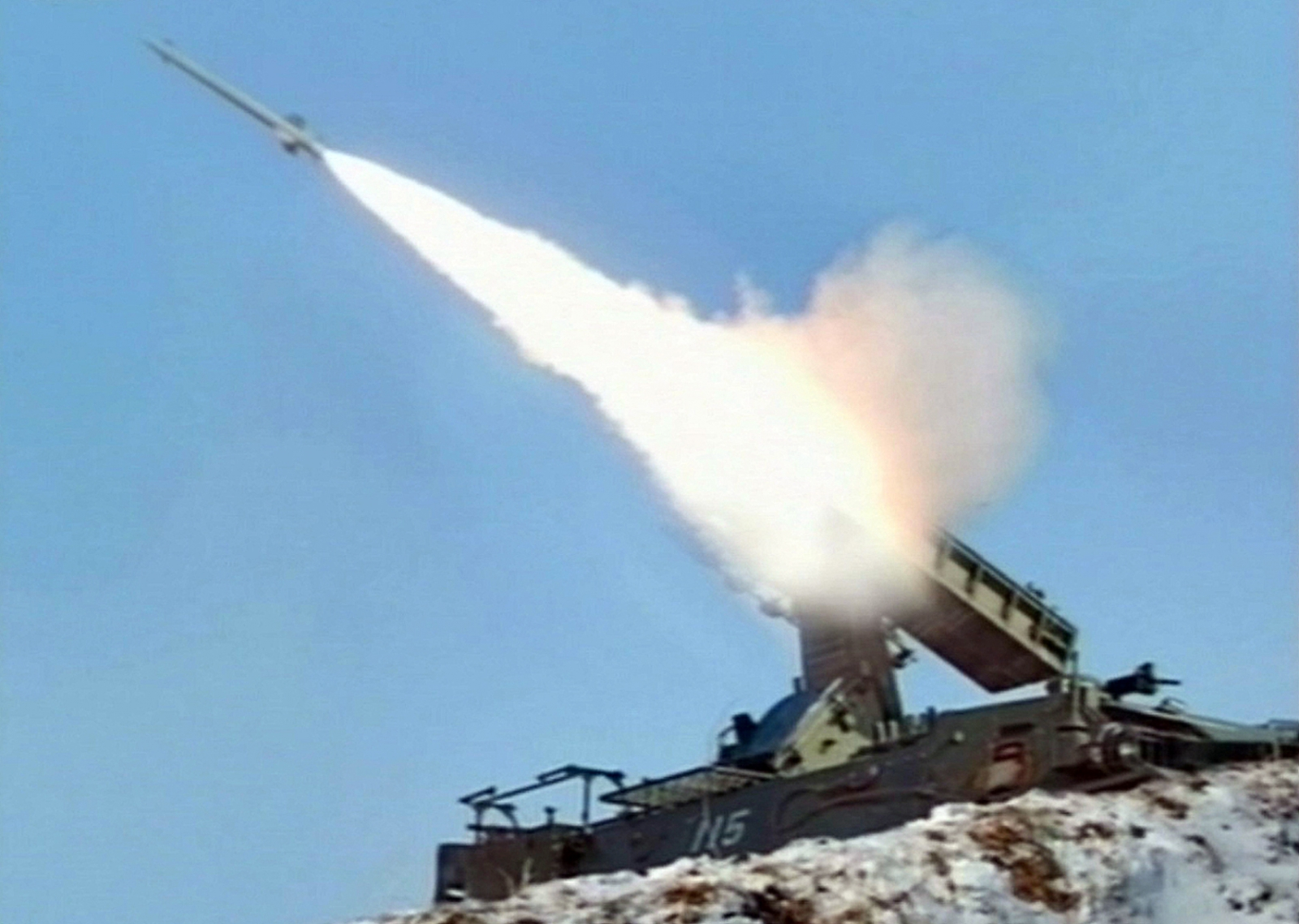 Image from North Korean television shows a rocket being fired in military exercises. (Getty)