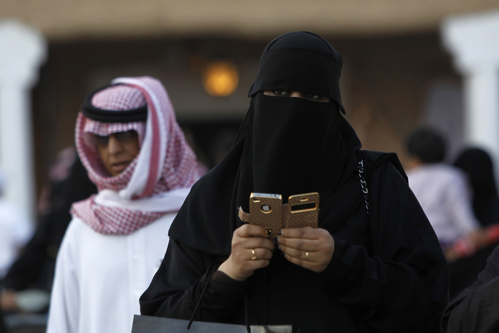 A woman using an iPhone visits the 27th Janadriya festival on the outskirts of Riyadh in this February 13, 2012 file photo.