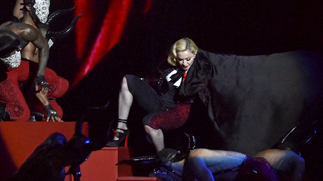 No capes! Brit Awards attendees amused and shocked after Madonna tumble