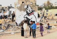 Banksy reveals new work in wry Gaza \'tourism\' video