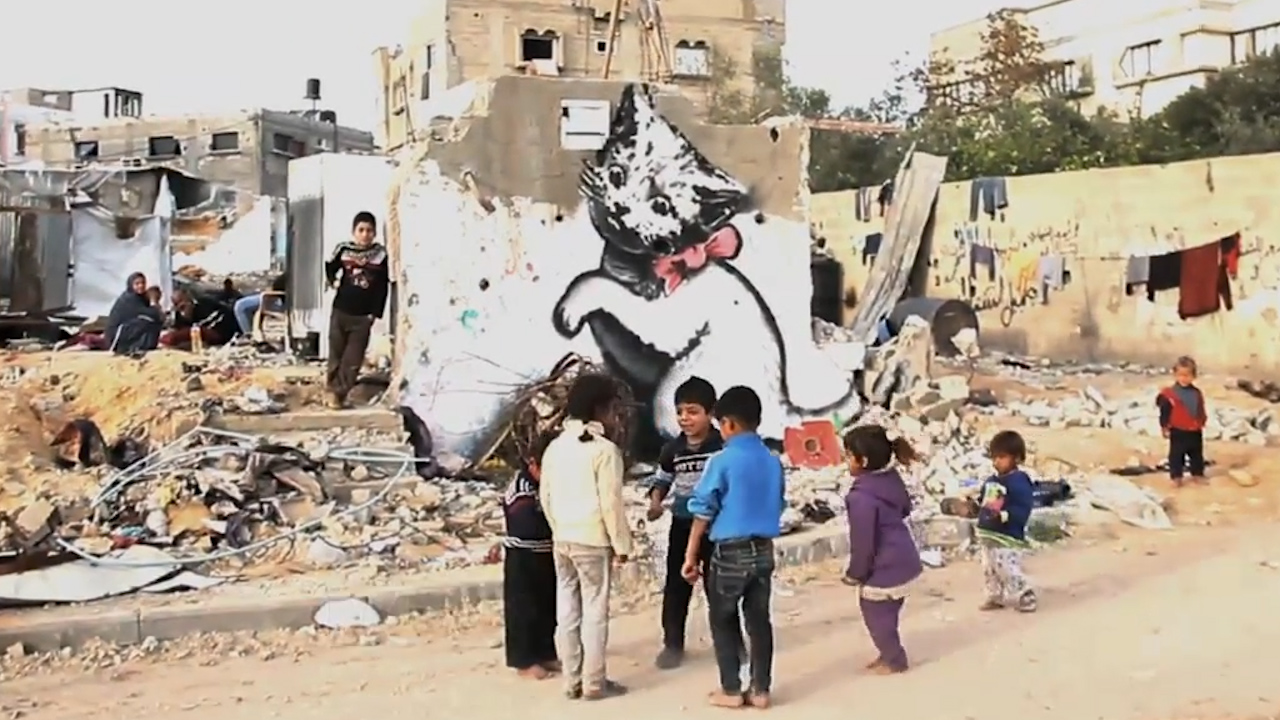 Banksy reveals new work in wry Gaza 'tourism' video