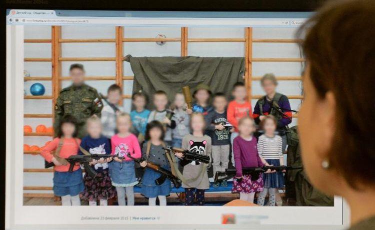Russian children with Kalashnikovs
