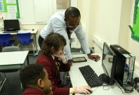 coding teacher with pupils computing UK