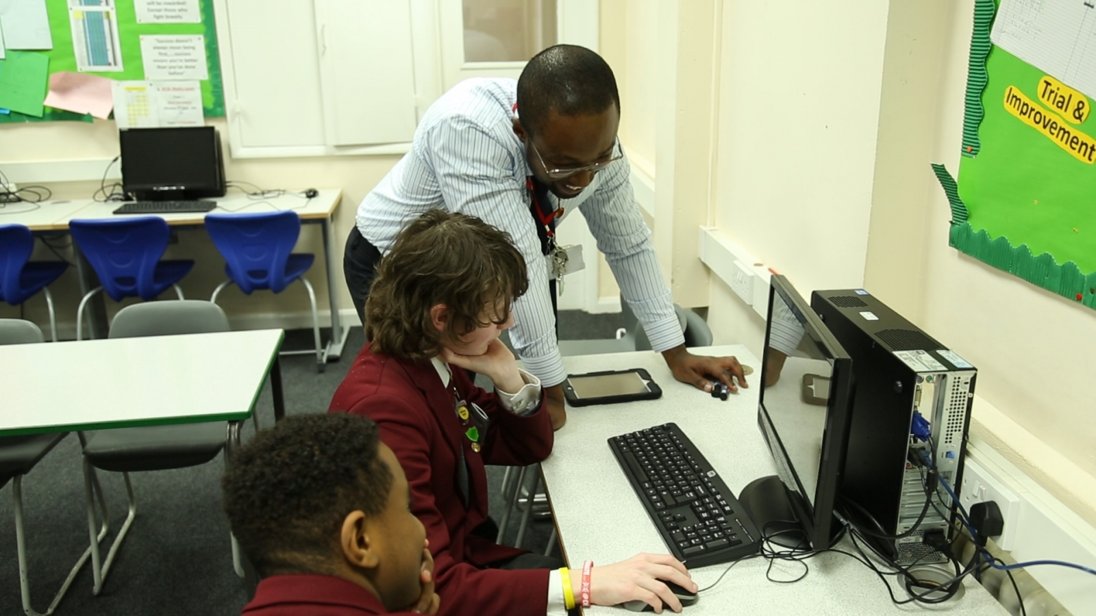 coding teacher with pupils computing UK