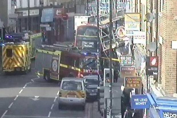 Scaffolding lies against bus in Peckham Road