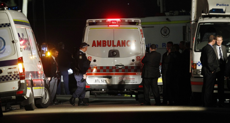 Ambulance arrives outside a house where bomb squad officers were working to protect an 18-year-old girl in Sydney