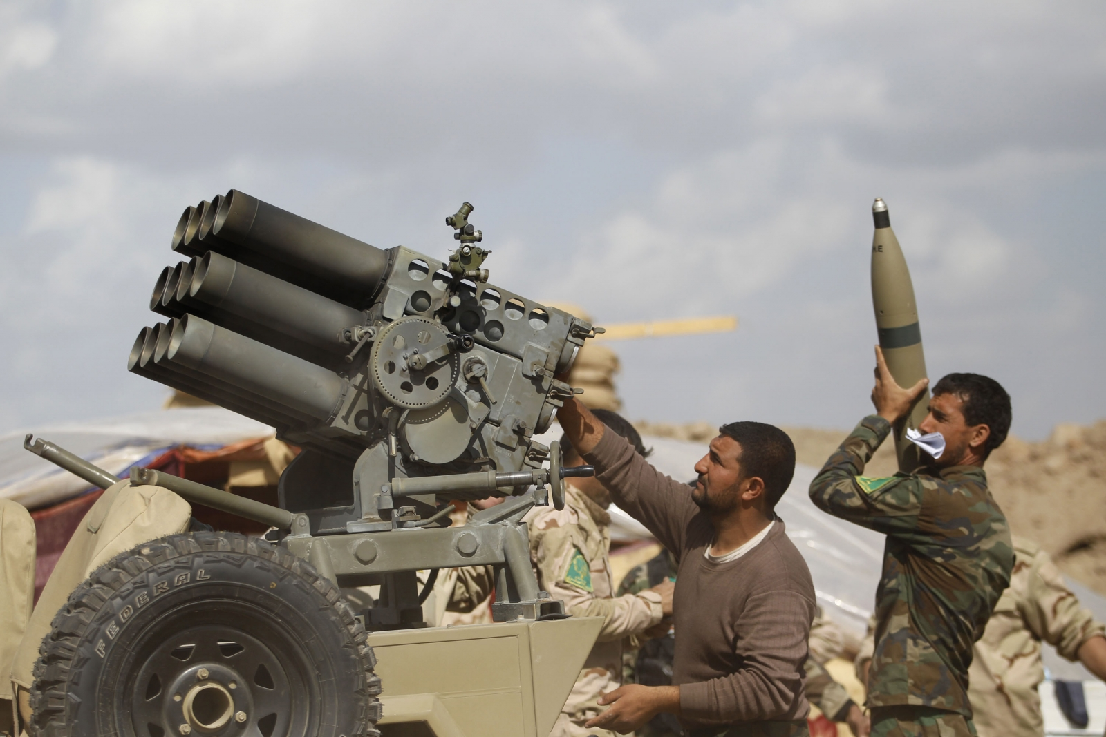 Iraqi forces launch a rocket attack