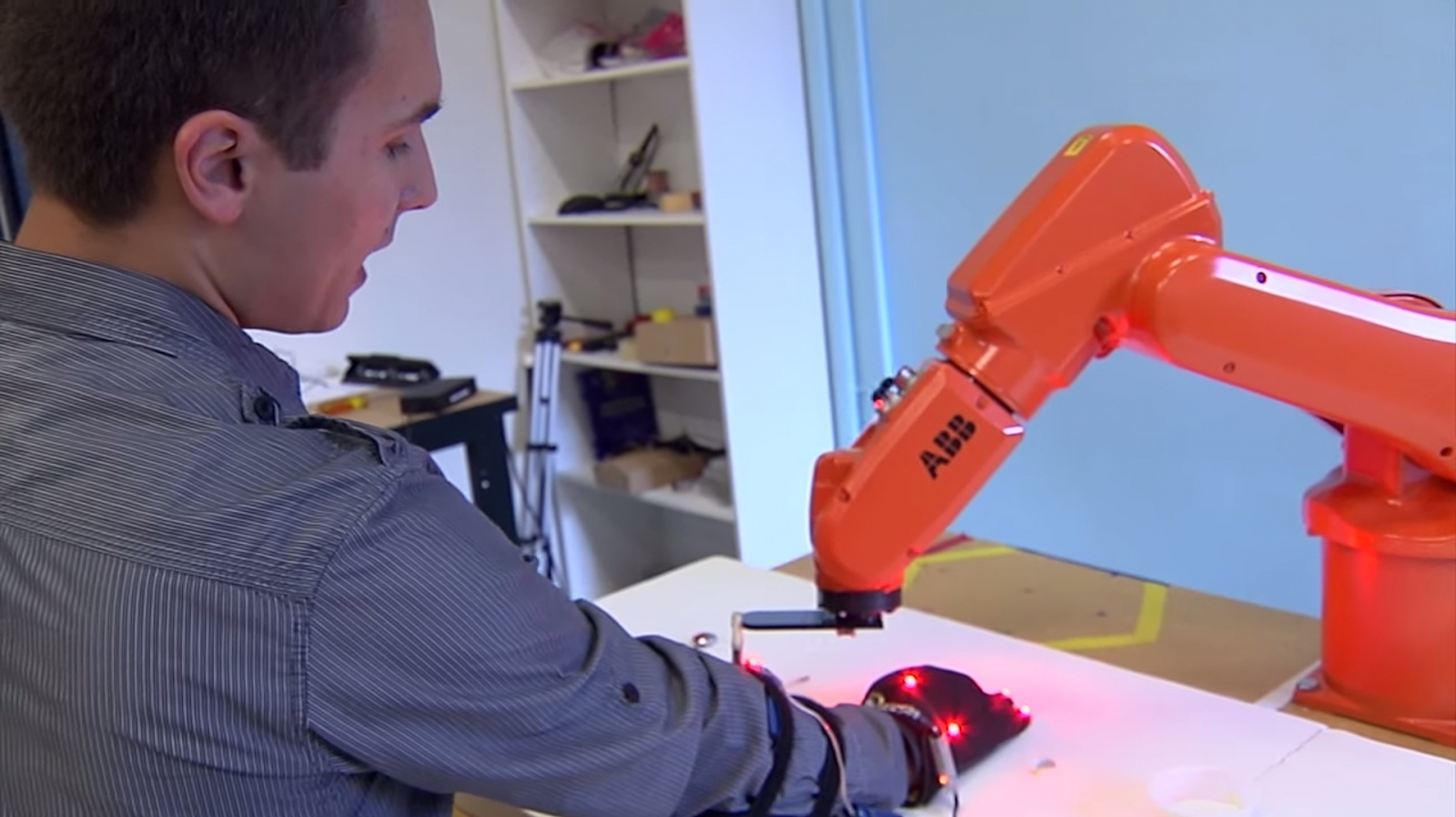 MIT's robot arm working with a researcher