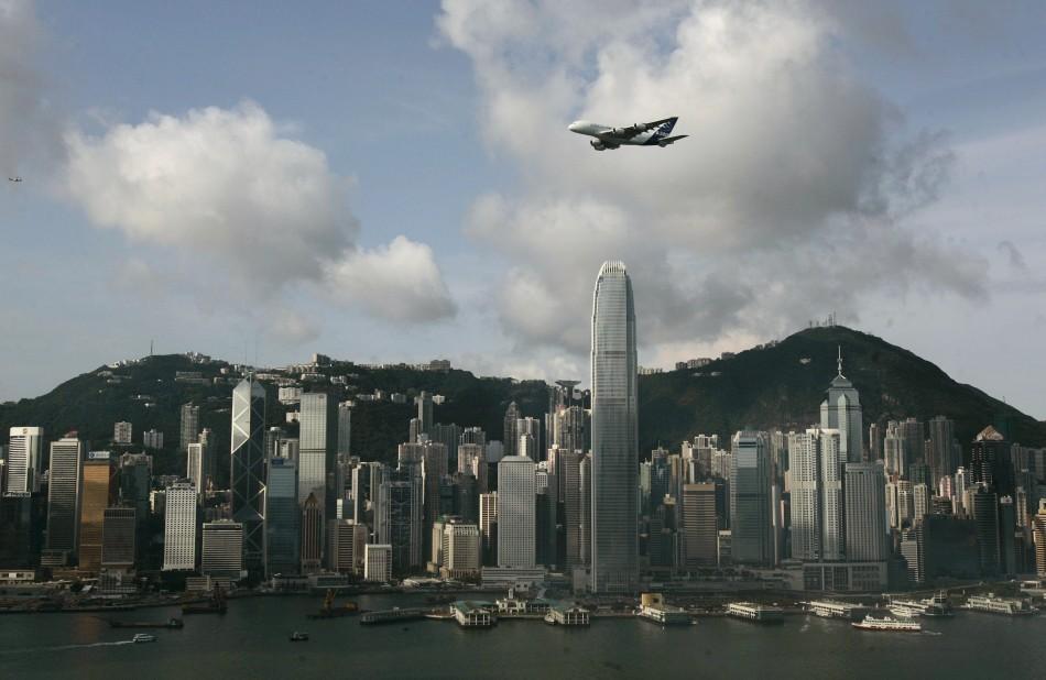 An Airbus A380 flies over Hong Kong's Victoria Harbour in Hong Kong