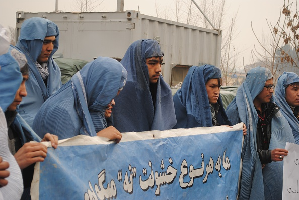 Kabul men burqa protest women violence
