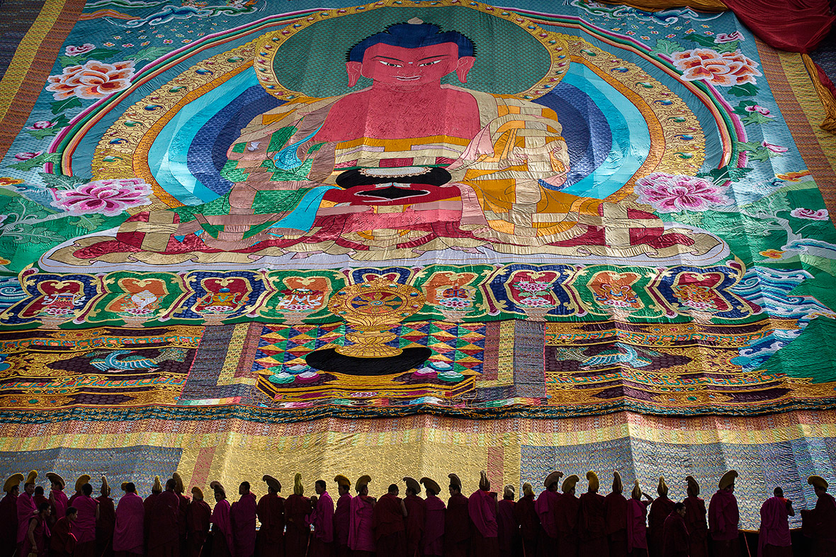 China: Tibetan Buddhist monks unveil giant painting of
