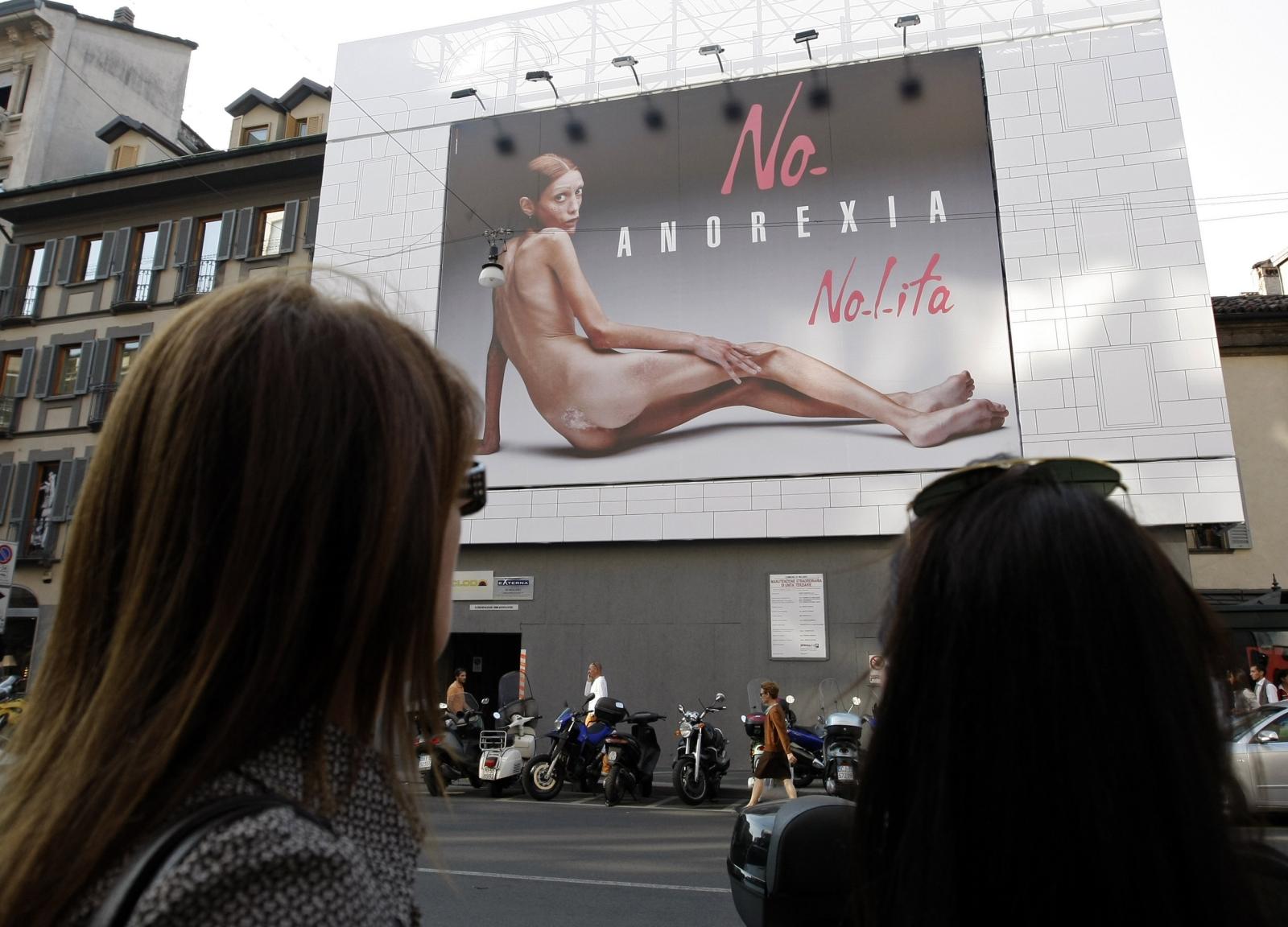 Emaciated woman billboard Milan