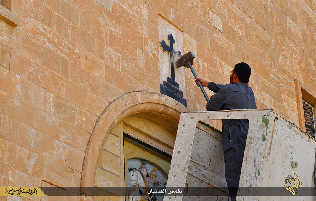 Isis smashing crosses St George monastery