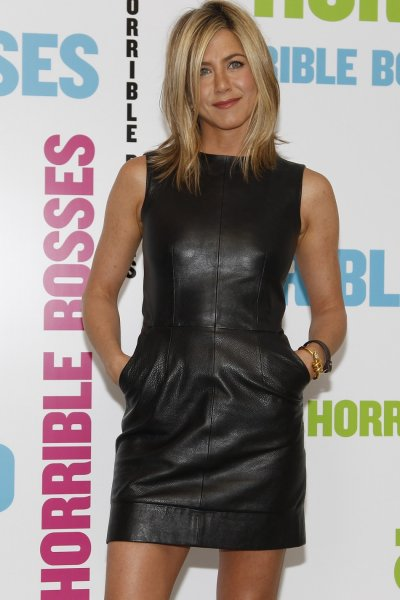 Actress Jennifer Aniston poses during a media event to promote her latest movie quotHorrible Bossesquot, at a hotel in London