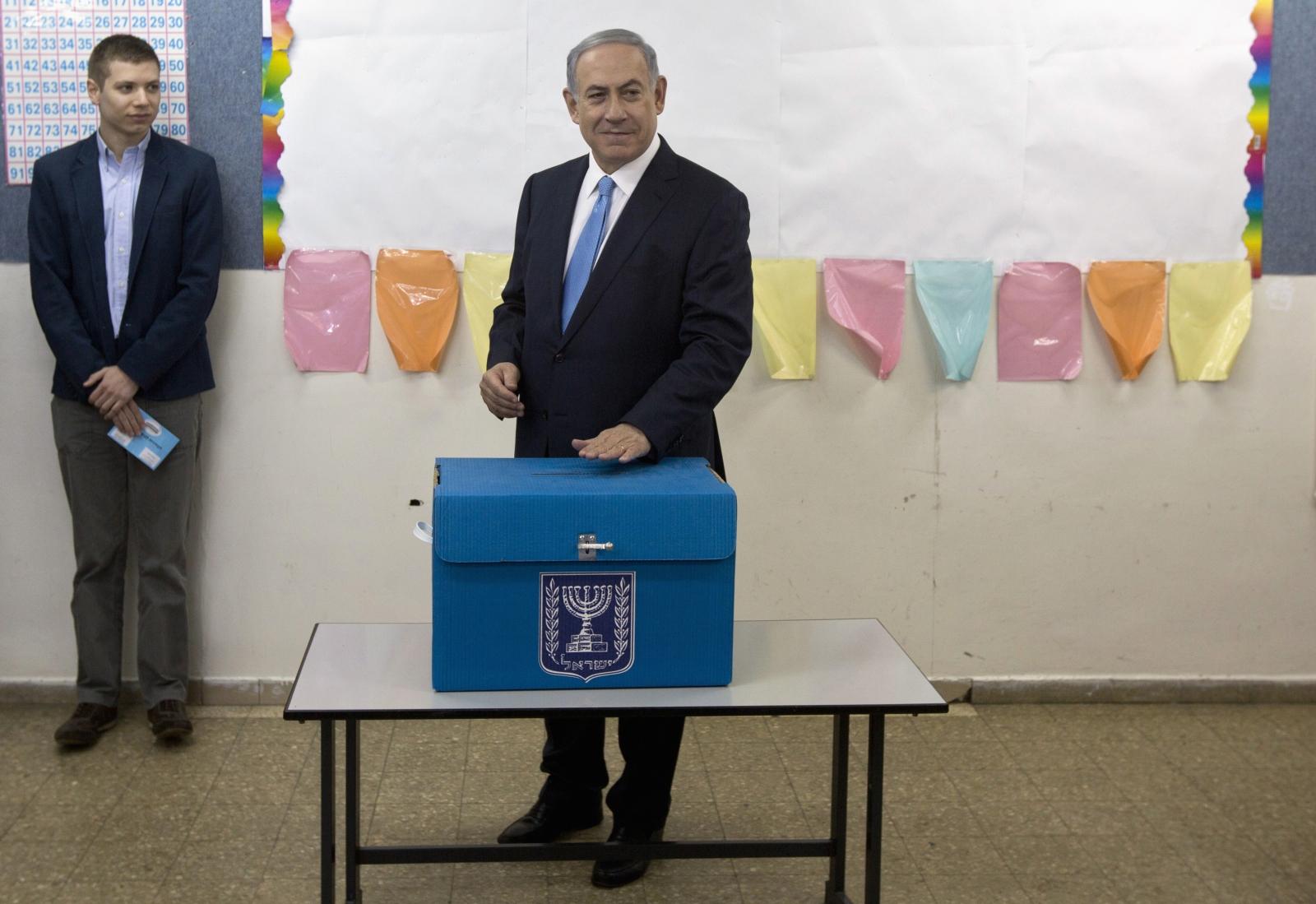 Benjamin Netanyahu casting his vote