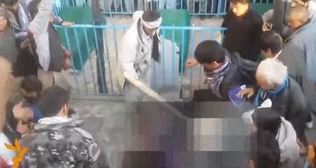 Afghan woman beaten to death