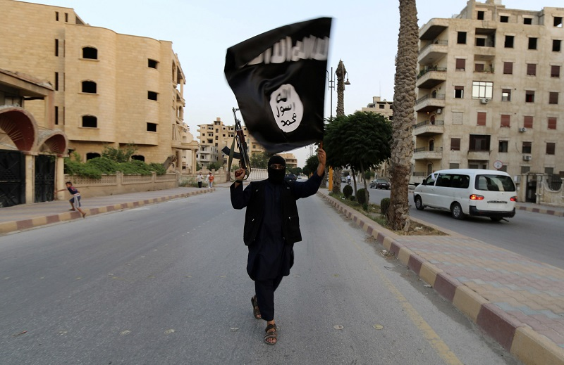 Islamic State Isis fighter with flag
