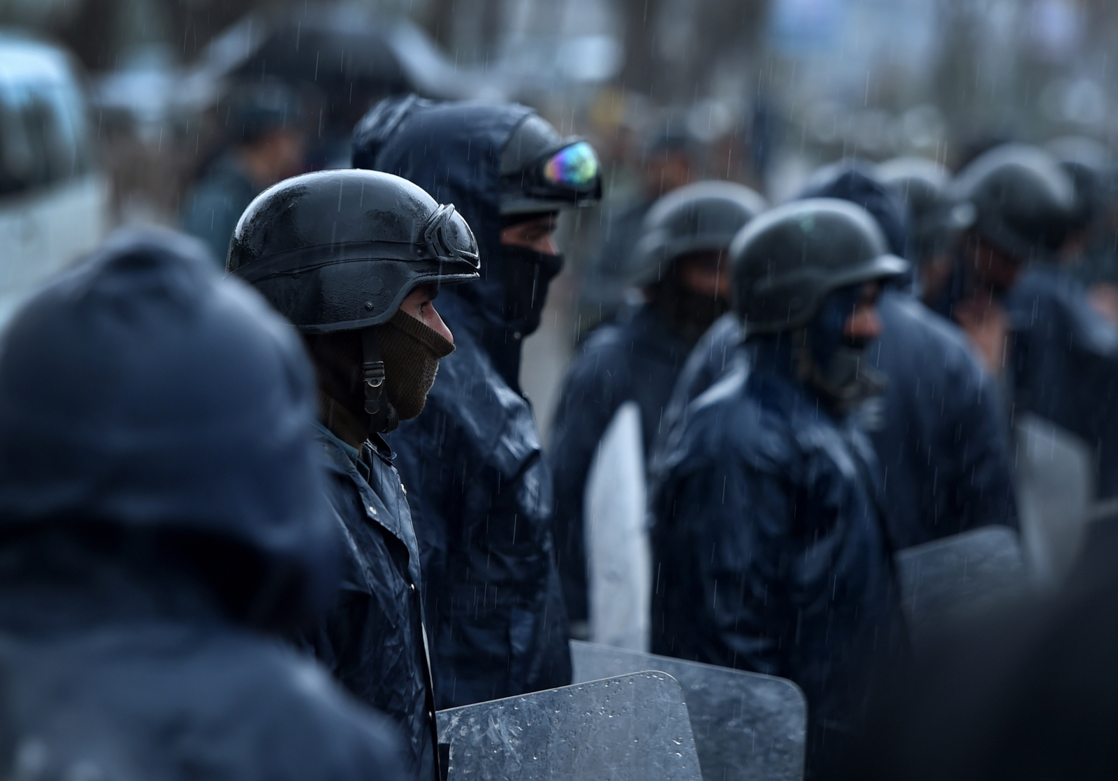 Afghan riot police stand guard
