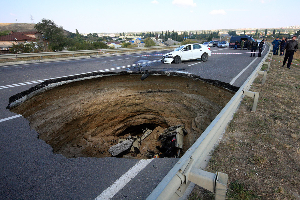 Sinkholes around the world: Vehicles and houses swallowed up by ...