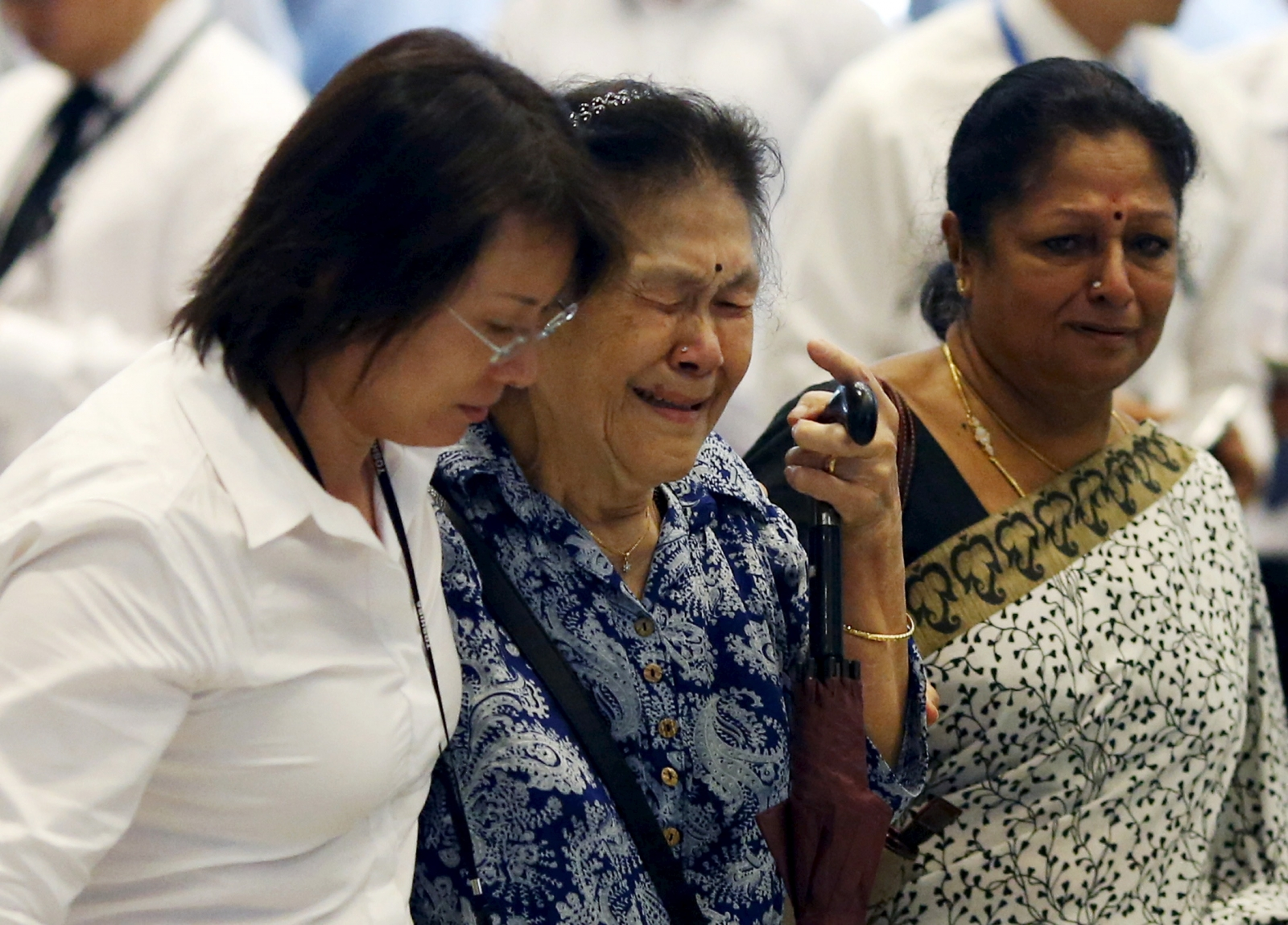 A woman cries Lee Kuan Yew's death
