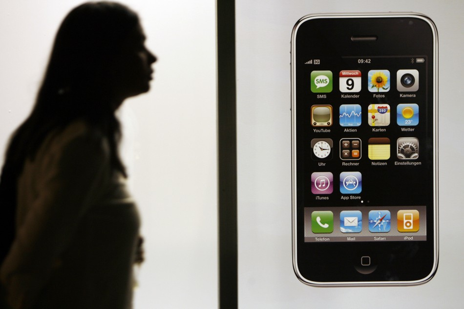 Woman  walks past Swisscom store before joining queue to buy Apple's iPhone 3G after it went on sale in Zurich