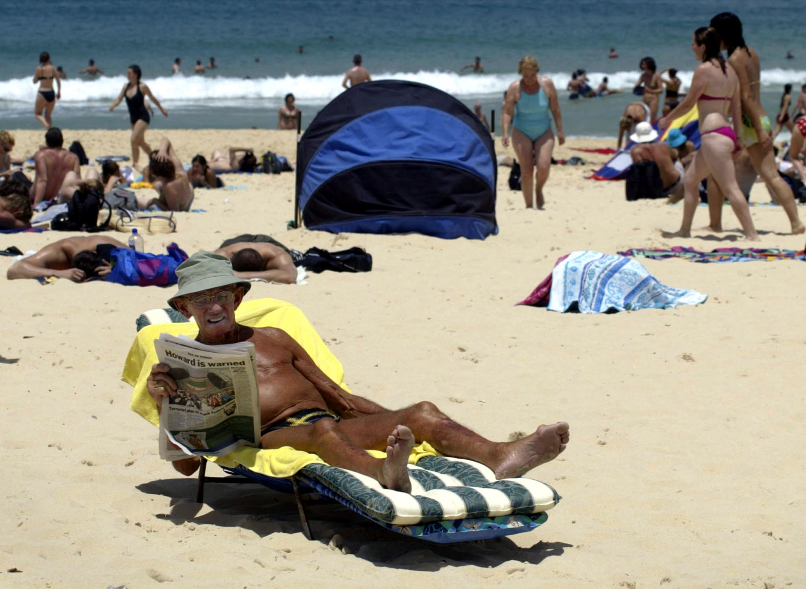 Elderly man sunbathing
