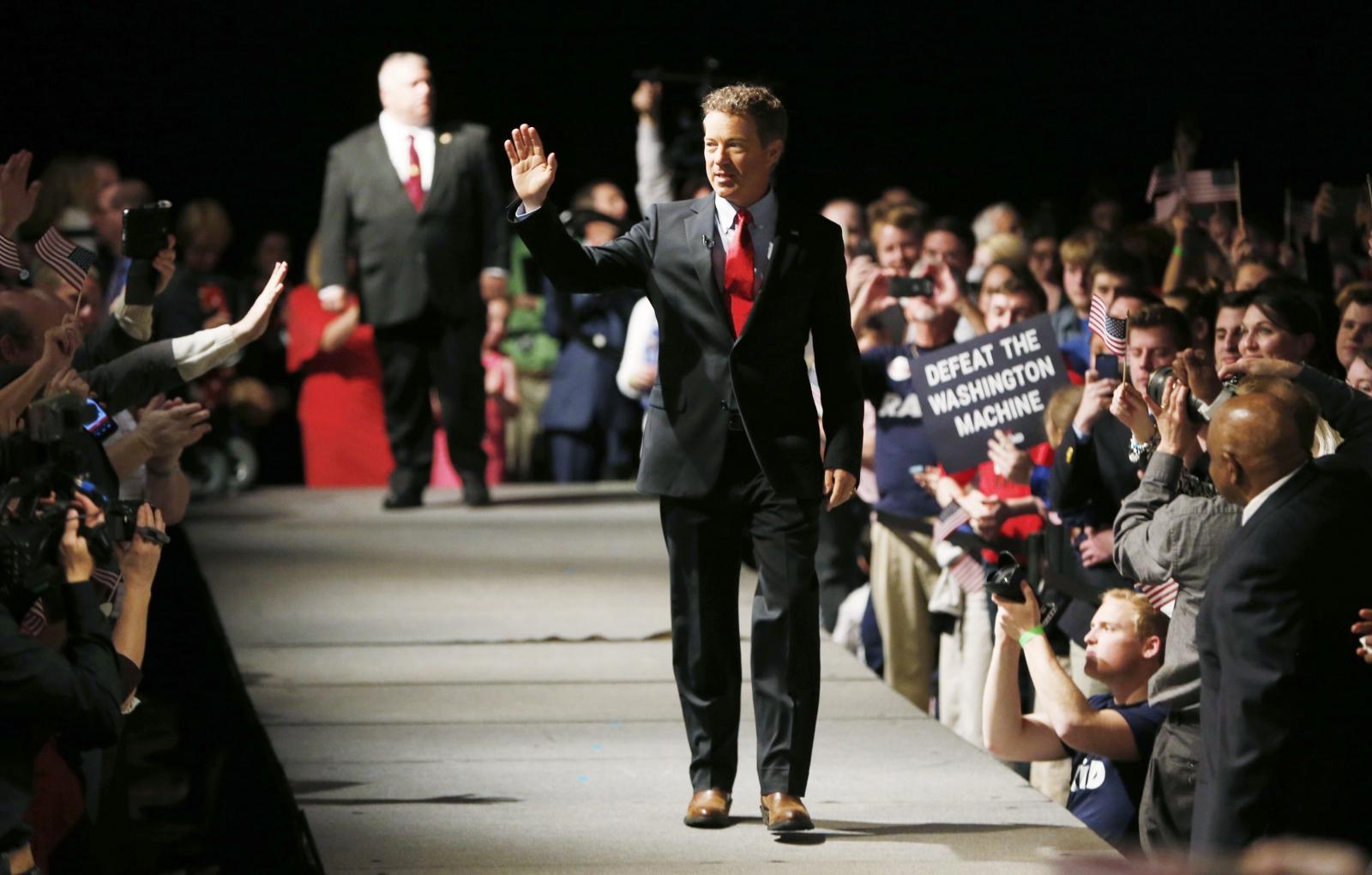 Rand Paul walks on stage in Louisville