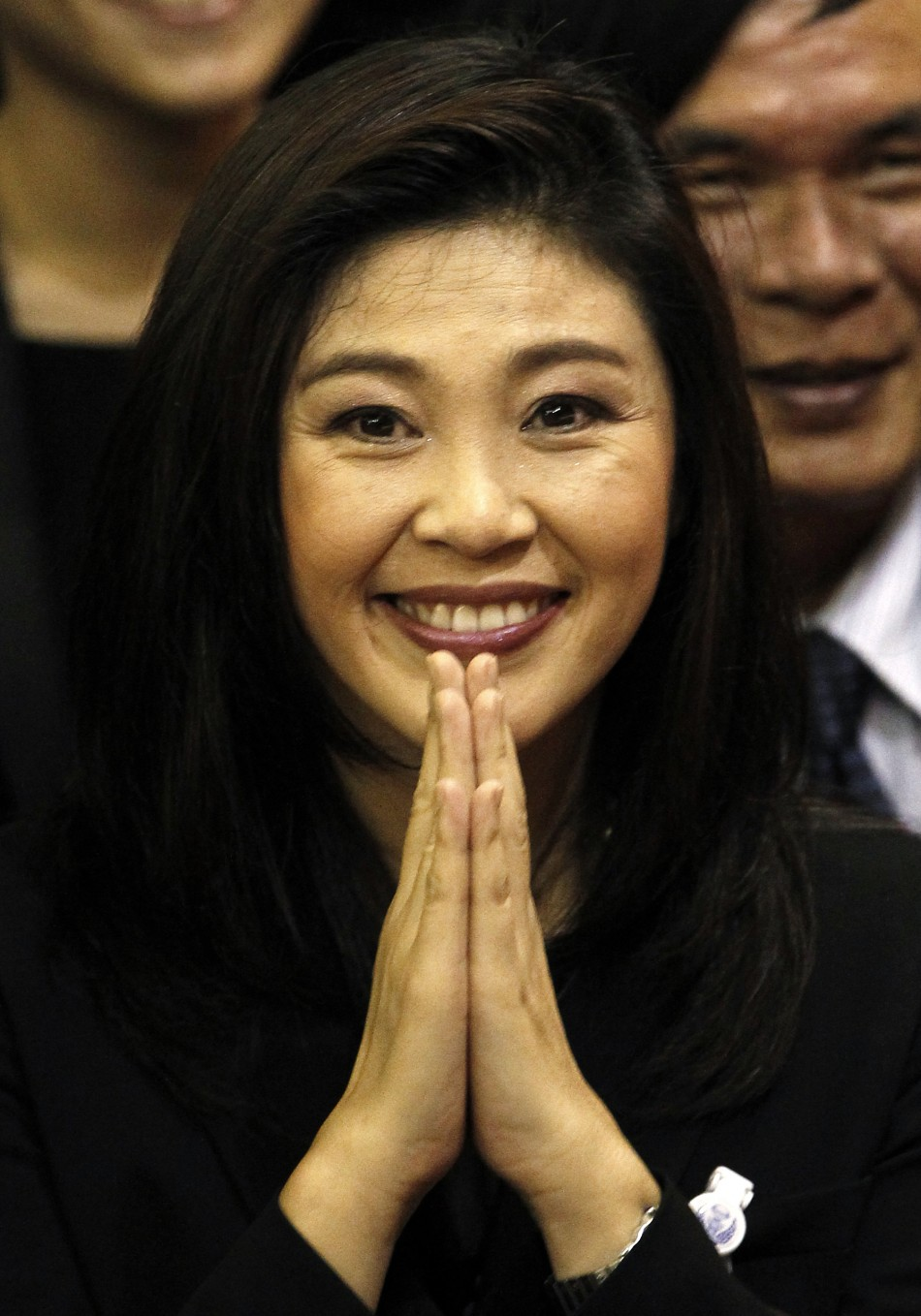 Thailands new PM Shinawatra of the Puea Thai Party gestures to members of parliament moments after being elected as the countrys 28th prime minister in Bangkok
