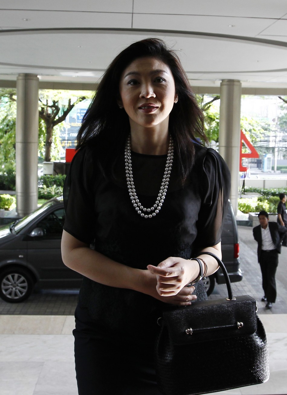 Thailands prime minister elect Yingluck arrives for work at the headquarters of her Puea Thai Party in Bangkok
