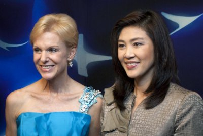 Thailands Prime Minister-elect Yingluck Shinawatra gives United States ambassador Kristie Kenney flowers in Bangkok