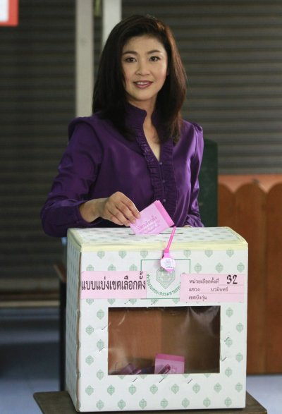Puea Thai Partys candidate Yingluck Shinawatra drops her vote into a ballot box at a polling station in Bangkok