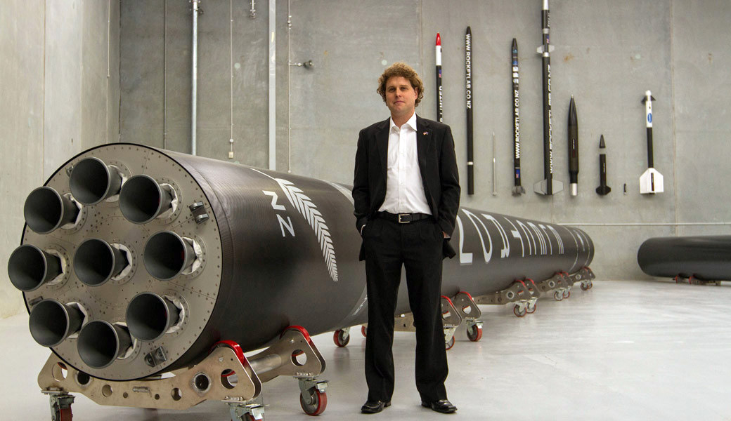 Rocket Lab CEO with the Electron rocket