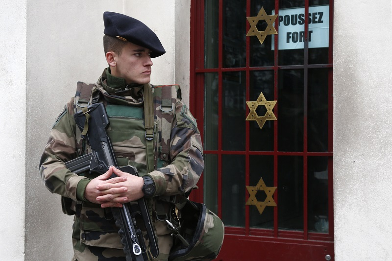 French Soldier protects a Parisian Jewish building