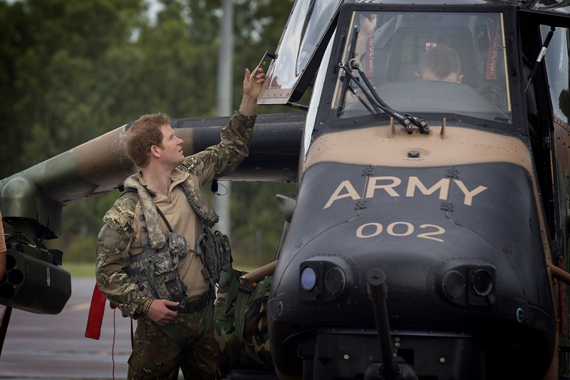 Prince Harry with Tiger helicopter