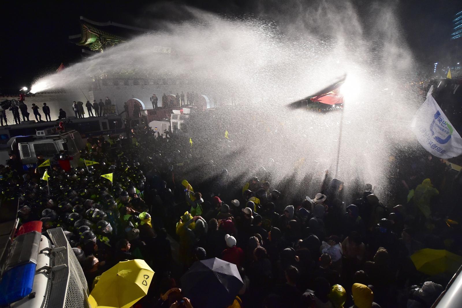 Riot police spray protesters in Seoul