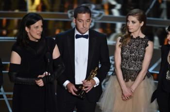 Laura Poitras and Glenn Greenwald at Oscars
