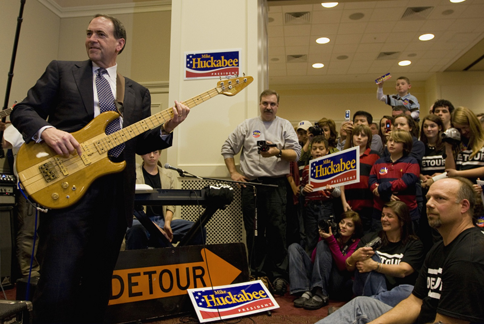 Mike Huckabee plays bass guitar