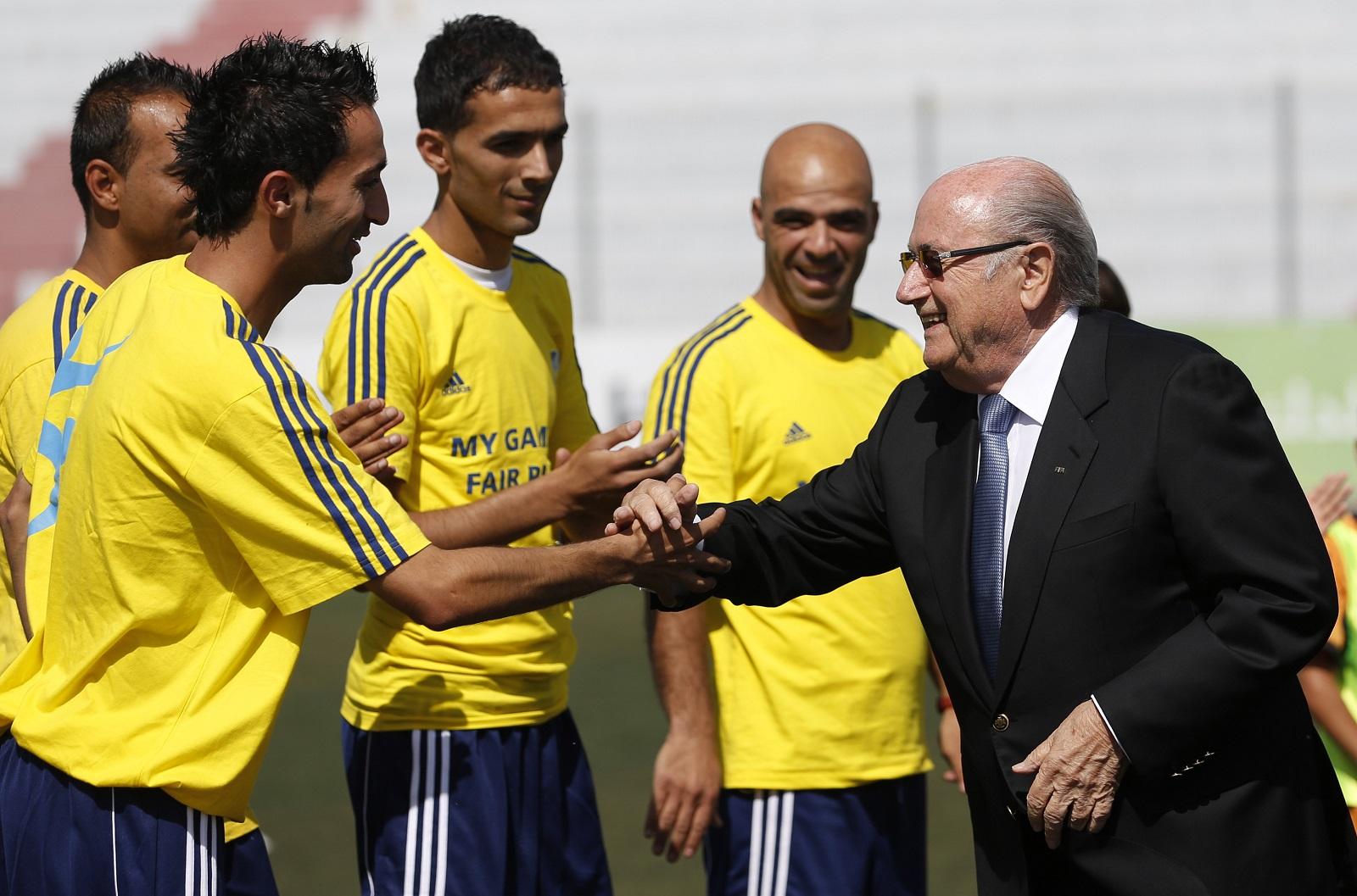 Sepp Blatter and Palestinian footballers