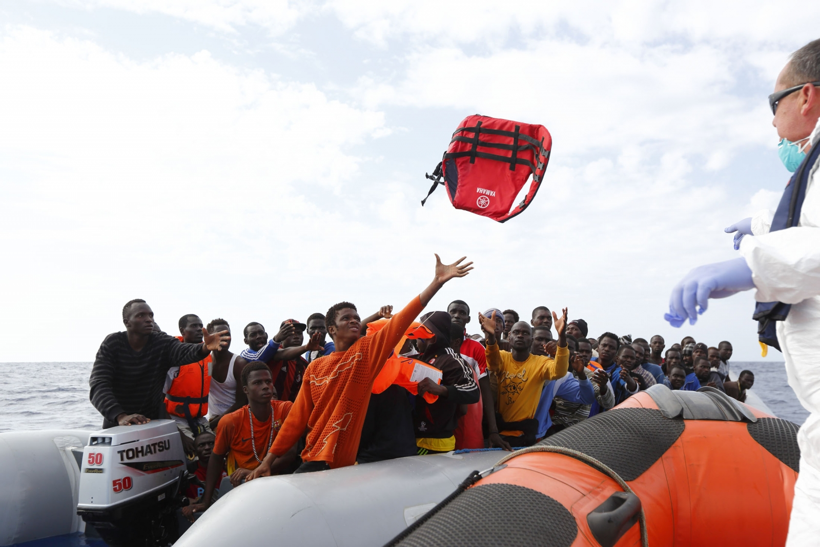 MOAS crew throwing life jackets to migrants