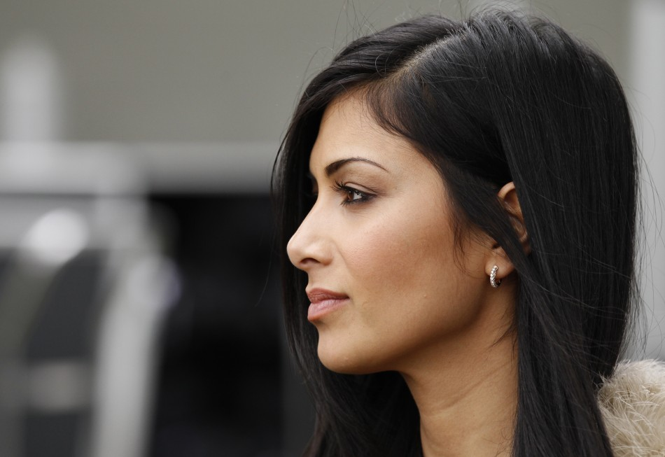 Scherzinger, girlfriend of McLaren Formula One driver Hamilton of Britain, is seen in the pits before the qualifying session of the Australian F1 Grand Prix at the Albert Park circuit in Melbourne