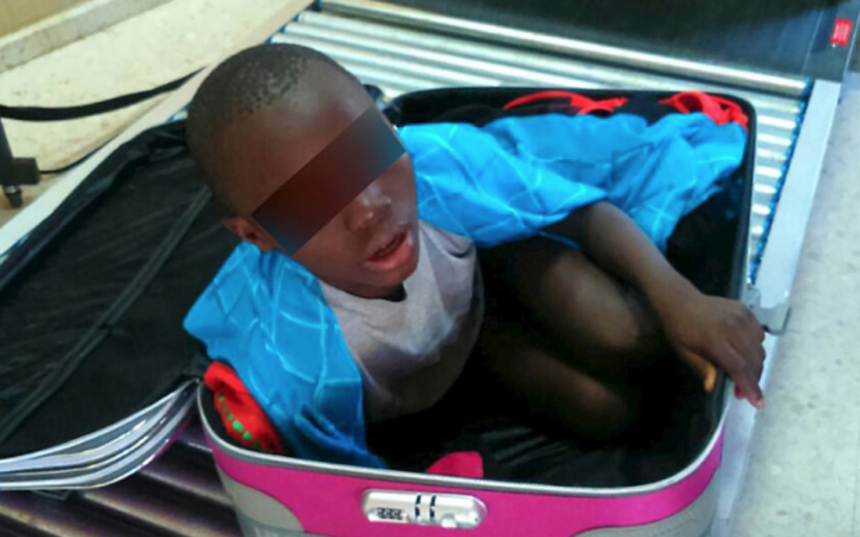 Eight-year-old smuggled in suitcase