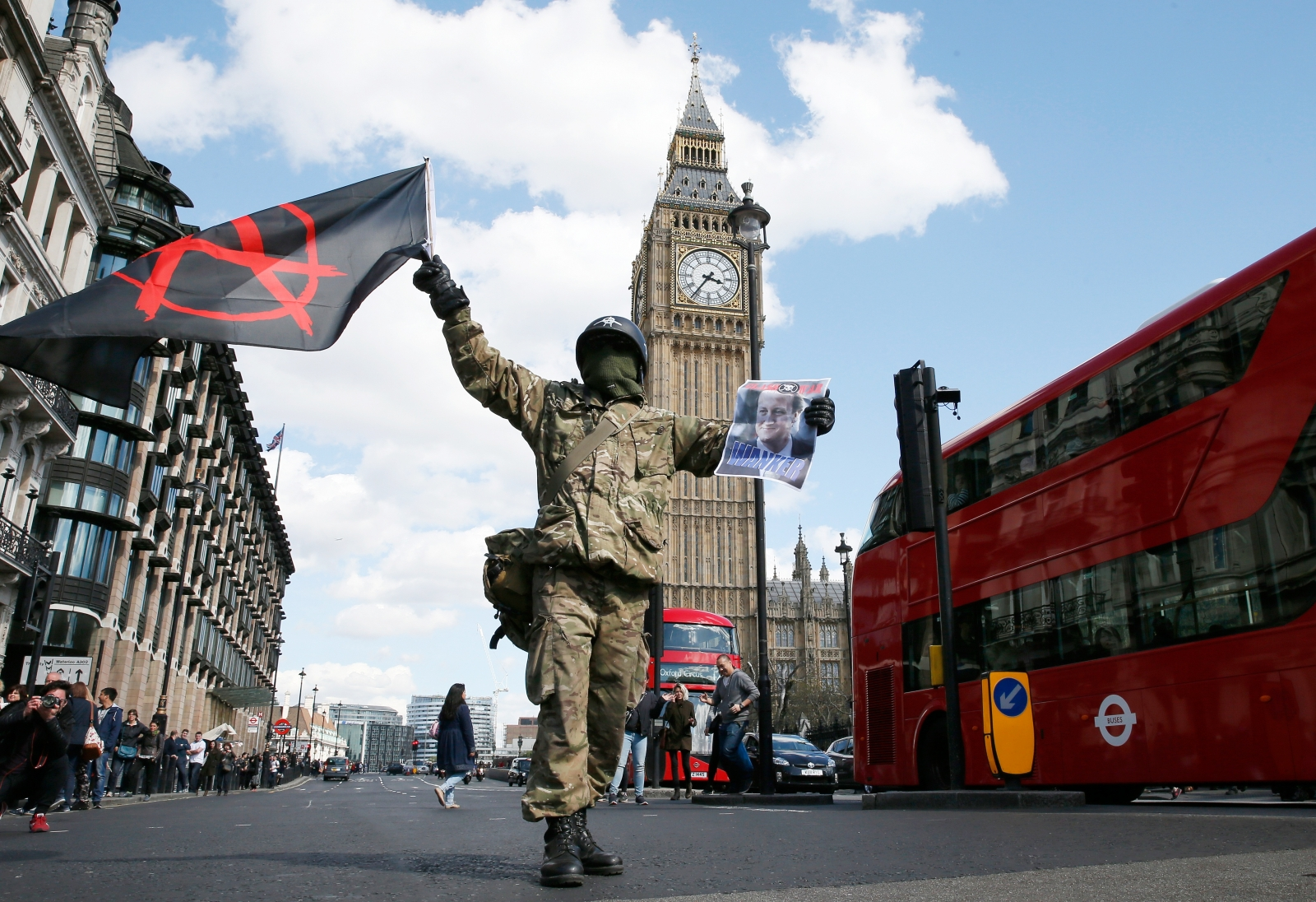 Protestor holds an anarchist flag