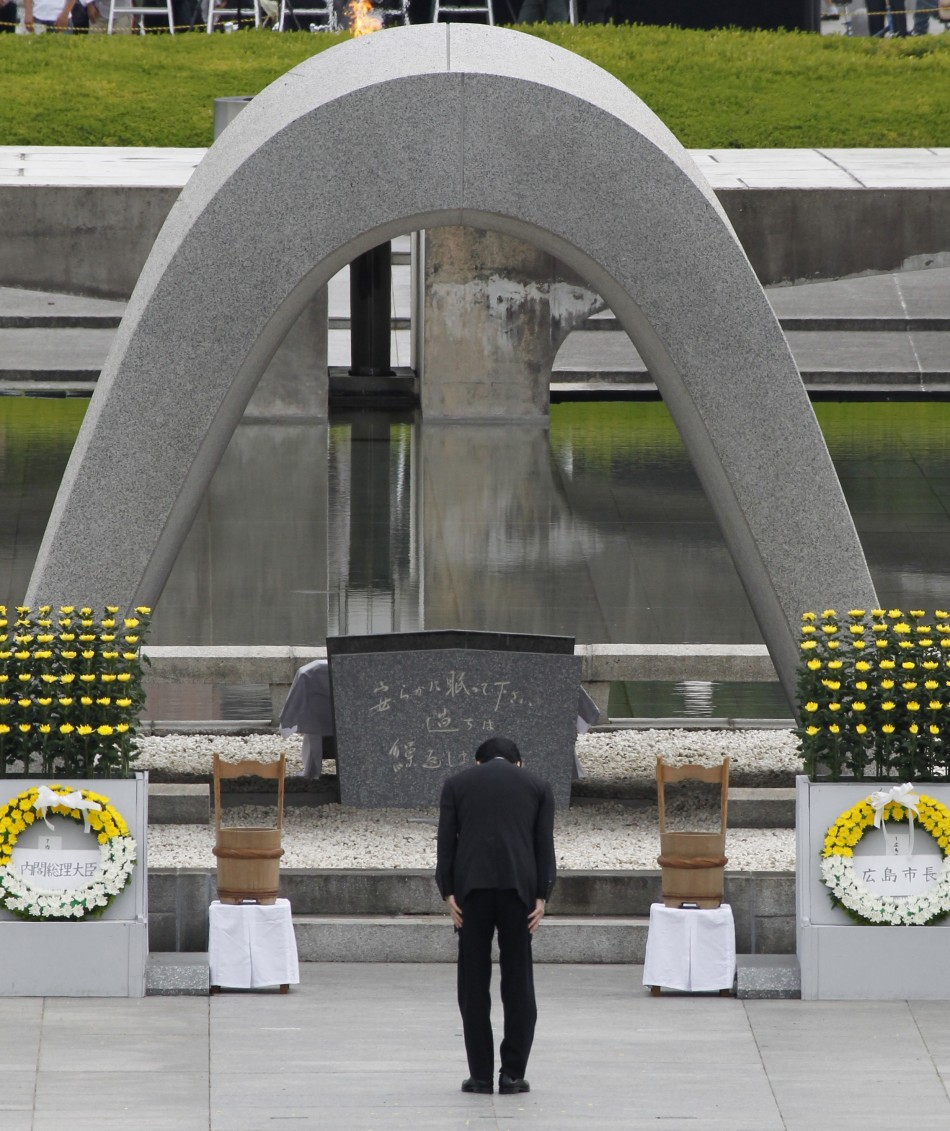 Japan's Prime Minister Naoto Kan bows