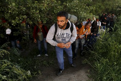 migrants Greece Macedonia Serbia Germany