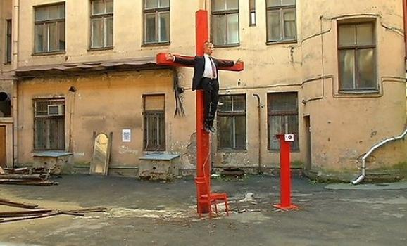 Putin crucified outside the Riga headquarters ofthe